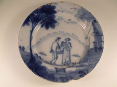 A Lovely C18th English Delft Plate  - c1760 - 22.5 cm diam    eBay Typical rim chips, and slight cracks to rim and into the centre, not showing through to the back in centre. See photo's.  c1760  22.5 cm diam 91.00
