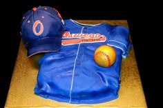 Golden birthday for a player of local travelling baseball team. Marble cake, vanilla buttercream. Hat and Jersey are cake. Golden baseball is RKT. Hat rim is gumpaste base. All decorations in fondant, baseball stitching in buttercream.     Baseball