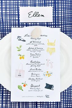 Adorable Illustrated watercolor menu and hand calligraphed place cards on a punchy, pop tablecloth. www.thecasualgourmet.com