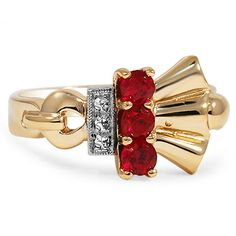 The Mateja Ring from Brilliant Earth circa 1930's This exquisite ring from the Retro era showcases a perfect row of three lavish rubies in a vivid red hue within a distinctive setting made complete by diamond accents framed in fine milgrain and a beautiful fan of inviting yellow gold (Rubies approx. 0.48 total carat weight).