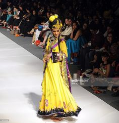 A model presents a creation by Pakistani designer Ali Zeeshan on the first day of Pakistan Fashion Design Council Sunsilk Fashion Week in Lahore on February 16, 2010. Fashion week will showcase 32 local designers over the four-day event with twists on traditional Pakistani dress and western styles.