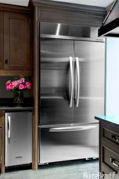 Refrigerator    The 42-inch KitchenAid French Door refrigerator from the Architect Series II has more capacity than any other built-in bottom-mount refrigerator. Next to it is a matching ice maker, for large parties.