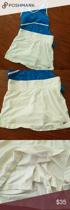 Like new Nike workout / tennis outfit size XS & S tank top is Small with built in bra bottoms are XS but fit like small and they are skorts Nike Tops Tank Tops
