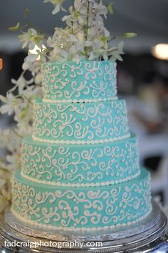 Turquoise Wedding Cake With White Orchid Flowers. Photo By Tad Craig  Photography