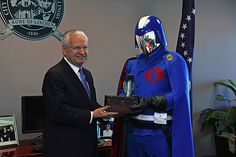 Springfield, Illinois mayor J. Michael Houston recently presented Cobra Commander, G.I. Joe super villain and leader of the organization known as Cobra, with a key to the city to celebrate the upco...