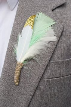 Mint and gold dipped feather buttonholes.