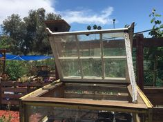 Upcycled Windows Into Small Greenhouse