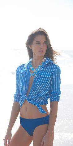 Seaside Chic: The striped blue and white cotton shirt layers perfectly over swimwear. Discover more at the Lauren Ralph Lauren Swim Shop.