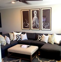 love dark grey couch with light coloured and cream pillows.