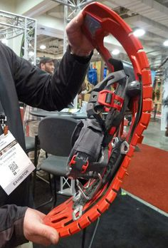 TSL Synbioz Elite Snowshoes These injection-molded snowshoes look like a zipper in profile. The outer edges are serrated and provide a good deal of flex, as shown. Three versions of the Elite are available now (in order of springiness due to the insert): Hyperflex (carbon fiber insert, $299, 2.15 lb each), Expert (fiberglass insert, $269, 2 lb each), and Hiker (plastic insert, $239 (2.2lb each). The binding is well designed to adjust to boot size and securely/comfortably attach.