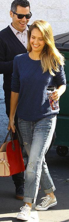 Who made Jessica Alba's blue jeans, red handbag, gold jewelry, sweater…