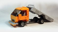 This LEGO truck represents simple european-style medium duty flatbed truck. You can use this truck as base fo. Lego Fire, Lego Truck, Lego Pictures, Lego Vehicles, City Car, Custom Lego, Lego Moc, Lego Creations, Legos
