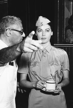 """George Cukor and Ava Gardner on the set of """"Bhowani Junction"""" (1956)."""