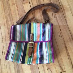 "Fossil KeyPer Flap Bag in Bright Stripe EUC! This messenger style bag is perfect for on the go. It's coated canvas with leather detail and heavy strap display the quality of Fossil bags. Cute multi-color body lined with a cute purple bird pattern inside. 12""X11""x4.5"". Fossil Bags Crossbody Bags"