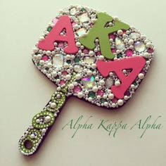 I'm pretty on my left..... I'm pretty on my right... This is a very glamorous sorority mirror for the lovely ladies of Alpha Kappa Alpha. Mirror is adorned in medium size hand painted wood letters in hot pink and green. Various sizes of pearls, pink/green gems, and fluorescent gems are also added to the back of the mirror. *This listing is for the item shown. Please note that bead placing will vary. I love a challenge so if you have an idea for a custom item, don't hesit...