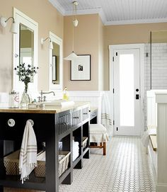 Next project - our bathroom. Elements I like: beadboard, tile, dark wood with white. And more. Ideas abound. Money? Not so much.