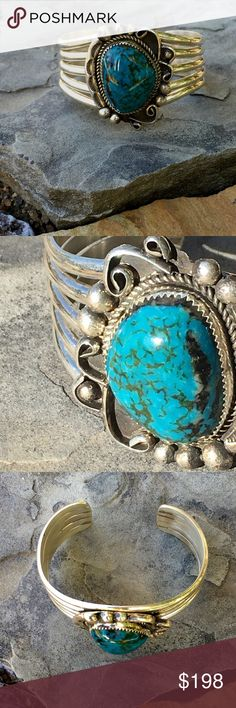 """Sterling Navajo Turquoise Cuff By Navajo Silversmith, Leslie Nez, this beautiful  Turquoise and Sterling Cuff is 1 3/4"""" Tall, and the inner circumference including gap is 6 3/4"""", Gap is 1 1/4"""", The Turquoise Cabochon is 22x29mm, Saw Tooth X Bezel set in Sterling, with Rope detail, Sterling Balls, Twirls and Stamped Designs. Hallmarked """"Sterling, LN"""", 75.g Navajo Leslie Nez Jewelry Bracelets"""