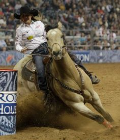 Carlee Pierce of Stephenville rides for a time of 14.47 to place first in barrel racing during round 1 of the Super Series II of RodeoHouston at Houston Livestock Show and Rodeo at Reliant Stadium Thursday, Feb. 28, 2013, in Houston.    Photo By Melissa Phillip/Houston Chronicle
