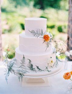 white wedding cake with whispy ferns | green wedding shoes