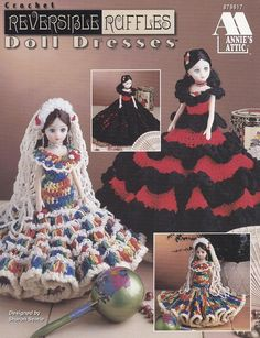 "Annie's Attic 'Reversible Ruffles Doll Dresses' Crochet Pattern Booklet #879817 Designs by Sharon Searle. Published 1996. Soft cover. 8 Pages. Patterns recommend worsted weight; baby pompadour yarn; and others. Finished outfits dress most 15"" fashion dolls. Patterns & Instructions"
