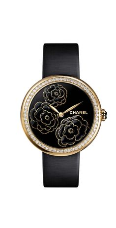 Chanel Mademoiselle Privé Camellia Maki-e watch in yellow gold and diamonds. The face is crafted using the ancient Japanese technique of Maki-e in black lacquer and yellow gold.