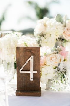 Wooden and metal table number: http://www.stylemepretty.com/california-weddings/santa-barbara/2017/02/01/spring-pastel-santa-barbara-wedding/ Photography: Michael and Anna Costa - http://www.michaelandannacosta.com/