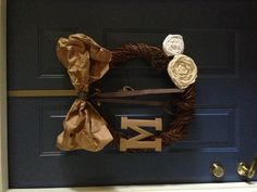 Paper bags, pizza box, ribbon, cloth and hot glue. DIY wreath. I already had the base. Made from vines cut down outta the yard.