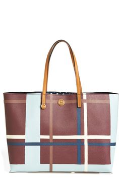 This plaid Tory Burch tote is perfect for storing and organizing all the day-trip essentials with ease.