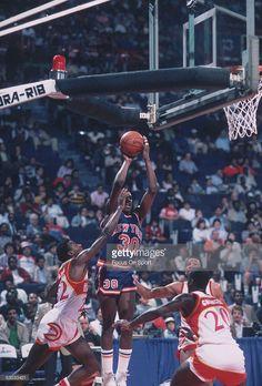 New York Knicks' Bernard King #30 makes a jumpshot against the Atlanta Hawks during a game circa 1984 in Atlanta, Georgia.