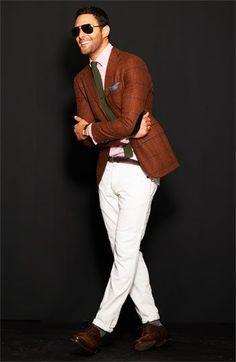 Shop this look on Lookastic:  http://lookastic.com/men/looks/sunglasses-dress-shirt-tie-blazer-belt-chinos-derby-shoes/8059  — Black Sunglasses  — Pink Dress Shirt  — Olive Wool Tie  — Tobacco Check Blazer  — Dark Brown Leather Belt  — White Chinos  — Dark Brown Leather Derby Shoes