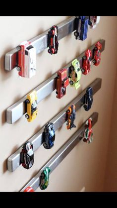 Toy metal car storage for #kids rooms - magnetic bars on the wall! #organizing #tips