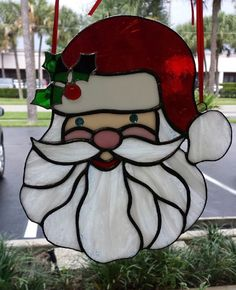 """Holly Jolly Santa Claus Stained Glass Suncatcher, Very """"Merry"""" Holiday Decoration, Custom Made, Ornament, 8"""" L and 7"""" W Free Shipping!. Celebrate the Holidays with This Awesome Holly Jolly Santa Claus Fun Santa Claus Ornament for Display or a Great Gift 8"""" L and 7"""" W Ships Quickly Ships Internationally Upon Request (Convo Me for Cost) Happy and intricate Santa Claus with a special Holly Berry on his stocking hat. He is so very merry and jolly and wanting to share the Holidays with you…"""