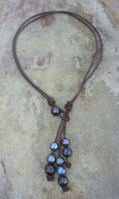 leather and pearl jewelry | ... pearl three strand necklace south sea pearls strung on leather to give ( possibly make as a long necklace with volcanic beads)