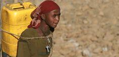 Girl in Amhara region of Ethiopia carrying water.