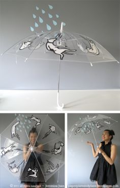 raining cats and dogs umbrella - clear umbrella embellished with a sharpie (would make an awesome gift, too!)