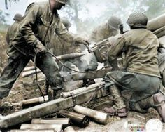 Artillery men of one the Cannon Companies of the three US 4th Infantry Division Regiments fire their 105 mm Howitzer M3 at German positions in Normandy 1944. (Possibly near Carentan, July 1944)