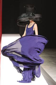 "purple beauty in motion, oversized ""my fair lady"" (with audrey hepburn) inspired black hat with bow...    (Yohji Yamamoto Spring 2012) <3"