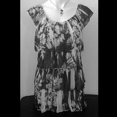 Floral Tiered Blouse Used, really good condition. Lightweight, stretchy and flowy shirt.   NOTE: Size Medium but can also fit a Large.   100% Polyester.  PRICE IS FIRM. Bundle and save! Sorry, no trades. Sienna Rose Tops Blouses