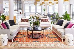 The design kicked off with a purchase of 80 large brass pendants that hang throughout the space and create an edgy industrial yet polished look. The timeline for the entire project was six months...