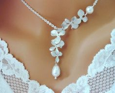 Falling white gold orchid and pearl necklace.  Ahh, perfect for a wedding dress or maybe an anniversary?