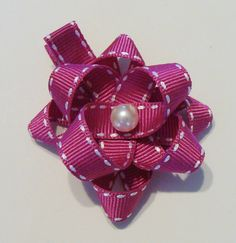 Fuchsia Pink Pearl Bead Center Daisy Hot Pink Saddle Stitched Ribbon Daisy Ribbon Flower Hair Clip. $5.00, via Etsy.
