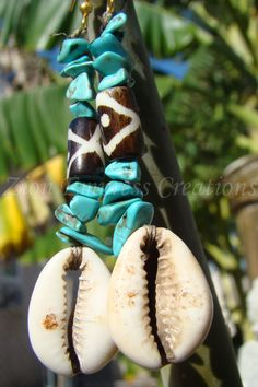 (Tribal Turquoise) Cowrie shell earrings! get them @ http://healingherbsbyrene.weebly.com/zion-empress-jewelry.html