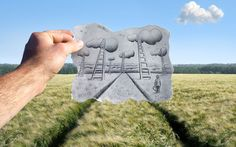 Belgian artist Ben Heine blends photography and pencil sketches to create imaginary scenes.