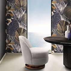 Gable is a sofa chair inspired in the heartthrob icon Clark Gable. It is upholstered in a luxurious cotton velvet, sit-on-top of a polished brass cylindrical base that swivels. Its low back and armless structure offers a bohemian twist on a classic lounge chair style.