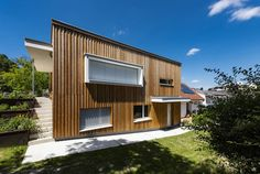 HAUS IN OBERPULLENDORF | AL Architekt Garage Doors, Shed, Outdoor Structures, Outdoor Decor, Home Decor, Wood Facade, House, Homes, Decoration Home