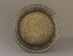 Basin (Baptistère de St. Louis). Muhammad ibn al-Zain. c. 1320–1340 C.E. Brass inlaid with gold and silver.