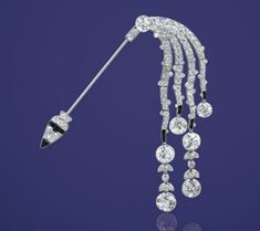 Lot 1996 - An Art Deco Diamond and Onyx Jabot Pin, by Cartier