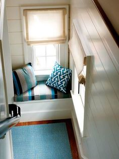 Maximize comfort and storage space underneath a large window with a cozy window seat. @ApartmentTherapy has rounded up how-to guides for installing one in your home.