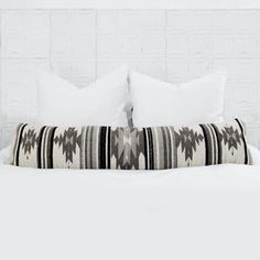 Handwoven in Mexico by The Women of Oaxaca Inspired by the geometric patterns used by the Zapotec tribes of the Oaxaca region, this lumbar pillow's structural designs and black and white color scheme