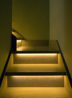 lights for stairs: Inventive narrow staircase design with golden LED lighting